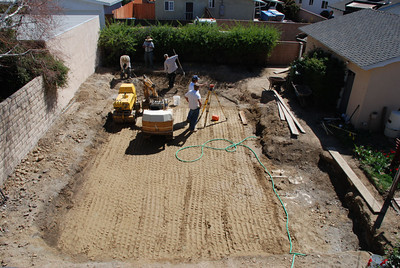 The dirt is in and level in the space formerly occupied by a swimming pool in Phil and Cil Rivera's Granada Hills backyard.