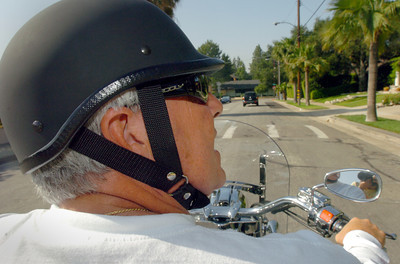 Grady Little, Dodger manager, rides his motorcycle down a street in Pasadena, Ca., on Wednesday, June 13, 2007.  (Tina Burch/Staff Photographer)