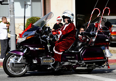 Mrs. Claus make her way down the parade on her goldwing bike during the annual Granada Hills christmas parade along Chatsworth blvd. Dec 4,2011. Photo by Gene Blevins/LA Daily News