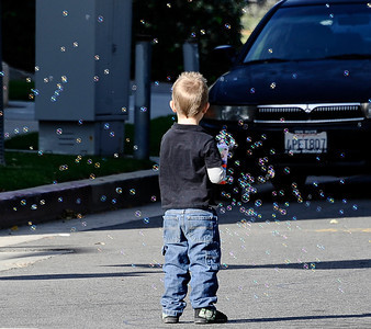Kids have fun with bubble guns during the annual Granada Hills christmas parade along Chatsworth blvd. Dec 4,2011. Photo by Gene Blevins/LA Daily News