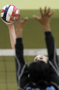 Granada Hill's Hanna Levanen #11 hits the ball as Carson's Kandance Thomas #7 defends during the CIF Los Angeles City Section Division I Girls Volleyball Championship at the Roybal Learning Center Saturday, November 20, 2010 in Los Angeles, CA. (Hans Gutknecht/Staff Photographer)
