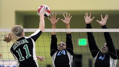 Granada Hills' Hanna Levanen #11 hits the ball as Carson's Toree Misaalefua #24 and Alisa Togia #18 defend during the CIF Los Angeles City Section Division I Girls Volleyball Championship at the Roybal Learning Center Saturday, November 20, 2010 in Los Angeles, CA. (Hans Gutknecht/Staff Photographer)
