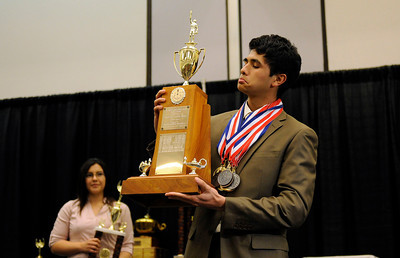 Granda Hills High School's Sean Wejebe looks at his trophy scoring the most points during the LAUSD Academic Decathlon Awards ceremony at the Los Angeles Convention Center in Los Angeles February 9, 2012. (Hans Gutknecht/Staff Photographer)