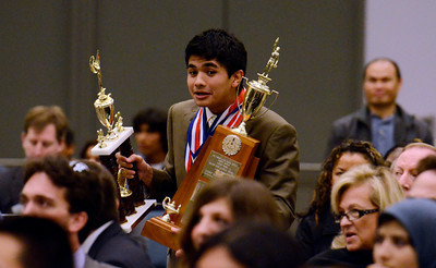 Granda Hills High School's Sean Wejebe walks back to his seat after winning top scoring competetor during the LAUSD Academic Decathlon Awards ceremony at the Los Angeles Convention Center in Los Angeles February 9, 2012. (Hans Gutknecht/Staff Photographer)