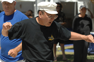 Roy Okada, who claims he should have been born a Greek, dances a traditional Greek line dance. The 36th Annual Valley Greek Festival is being held at St. Nicholas Church 9501 Balboa Blvd. in Northridge. Officials at the festival expect an attendance of over 50,000 durning the 3-day event. The admission-free fundraiser is the largest festival of its kind in the area and features Greek live music, dancing, gourmet food, homemade pastries, cooking demonstrations, children's activities, a Greek market, and a variety of shopping boutiques. Northridge, CA 5/29/2010. photo by John McCoy/staff photographer