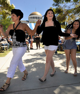 """Women join in a traditional Greek style line dance to the live music being played by """"The Olympians."""" The 36th Annual Valley Greek Festival is being held at St. Nicholas Church 9501 Balboa Blvd. in Northridge. Officials at the festival expect an attendance of over 50,000 durning the 3-day event. The admission-free fundraiser is the largest festival of its kind in the area and features Greek live music, dancing, gourmet food, homemade pastries, cooking demonstrations, children's activities, a Greek market, and a variety of shopping boutiques. Northridge, CA 5/29/2010. photo by John McCoy/staff photographer"""