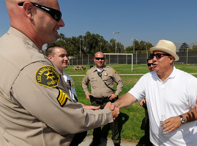 Community leader Blinky Rodriguez shakes hands with Sheriffs Deputies after the event. Los Angeles County Supervisor Zev Yaroslavsky and the Los Angeles County Department of Parks and Recreation held a groundbreaking ceremony for a state-of-the-art $11.5-million gymnasium and community center at El Cariso Park in Sylmar. The anticipated completion date for the new facility is late in 2012. Sylmar, CA. 10/15/2011(John McCoy/Staff Photographer)
