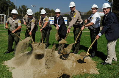 Los Angeles County Supervisor Zev Yaroslavsky, center, was joined Sheriffs Deputies in turning shovel loads of sand. Nearly everyone who attended the ground breaking took a turn at a photo opportunity to turn soil with the Supervisor. Yaroslavsky and the Los Angeles County Department of Parks and Recreation held a groundbreaking ceremony for a state-of-the-art $11.5-million gymnasium and community center at El Cariso Park in Sylmar. The anticipated completion date for the new facility is late in 2012. Sylmar, CA. 10/15/2011(John McCoy/Staff Photographer)