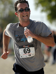 Glenn Cooper, 43, finishes the triathlon with a final time of an hour and 22 minutes. An estimated 1,000 participants took on the Hansen Dam Triathlon at Hansen Dam Aquatic Center in Lake View Terrace, Calif. on Sunday, Aug. 21, 2011. The course  included a 500-yard open water swim, an 11-mile scenic bike ride through rolling hills, and a 3-mile run through Hansen Dam Regional Park.  (Maya Sugarman/Staff Photographer)