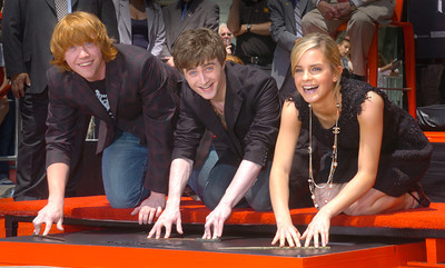 Left to right are Actors from Harry Potter movies, Rupert Grint, Daniel Radcliffe and Emma Watson, put their wands in cement in front of Grauman's Chinese Theatre on Monday, July 9, 2007 in Hollywood, Ca.  (Tina Burch/Staff Photographer)