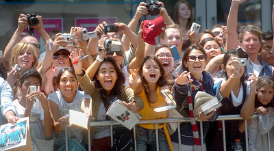 Fans of Harry Potter movies scream at actor Daniel Radcliffe on Monday, July 9, 2007, in front of Grauman's Chinese Theatre in Hollywood, Ca.  Radcliffe portrays Harry Potter in the movies.  (Tina Burch/Staff Photographer)