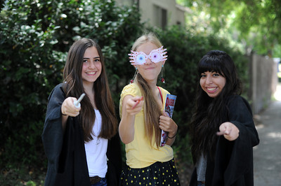 Jocelyn Vallejos, 15-years-old, Kelse Whitfield, 16-years-old, and Jennifer Escobar, 16-years-old, will be watching a marathon of Harry Potter movies in preparation for the final movie being released at midnight on Thursday. (Hans Gutknecht/Staff Photographer)