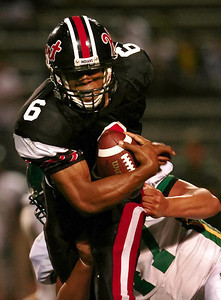 Hart High's Delano Howell gets held by Moorpark High's Marc Palacios as he runs the ball down-field in the first half the game played at College of the Canyons in Valencia, CA, on Friday Sept. 7, 2007 as Hart lead the first half 6-0. (John Lazar/L.A. Daily News Staff Photographer)
