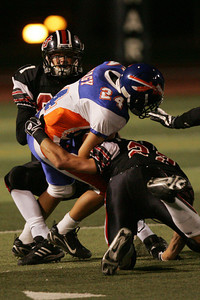 HART VS WESTLAKE--Westlake's Steve Hagy, 24, gets wrapped up by Hart's Brian Felt, 23, and  on the play.     Photo by David Crane/Staff Photographer.