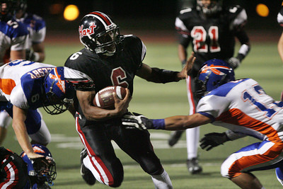 HART VS WESTLAKE--Hart's Delano Howell, 6, looks for running room to set up a first quarter TD for Hart.    Photo by David Crane/Staff Photographer.