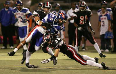 HART VS WESTLAKE--Westlake's Curtis Peterson, 20, gets wrapped up by Hart's Johnny MacArthur, 25, and Dakotah Luster, 81. Photo by David Crane/Staff Photographer.