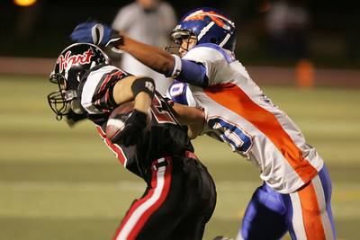 HART VS WESTLAKE--Westlake's Curtis Peterson, 20, can't get a hold of Hart's Brian Felt, 23, as Felt escapes for a first quarter TD on the play.     Photo by David Crane/Staff Photographer.