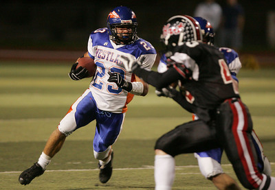 HART VS WESTLAKE--Westlake's Justin Lilley, 23, looks for room to run.    Photo by David Crane/Staff Photographer.
