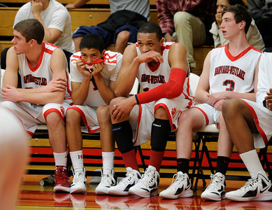 The Harvard-Westlake bench looks dejected in the final moments. Serra defeated Harvard-Westlake 62 to 50 in the Southern Section Division IV AA boys' basketball quarterfinals. Studio City, CA 2/21/2012(John McCoy/Staff Photographer)