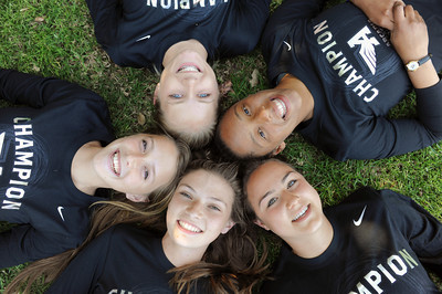 Harvard-Westlake runners Hilary King, far right, Amy Weissenbach, bottom left  Lauren Hansson, top center,  Cami Chapus, far left,  and K.C. Cord, bottom right,  posted the fastest times in the nation this year in both the sprint medley relay and distance medley relay at the Arcadia Invitational. (Hans Gutknecht/Staff Photographer)