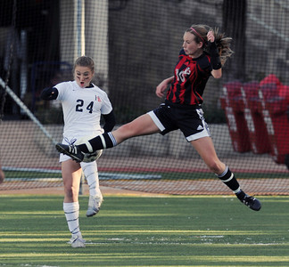 Harvard Westlake's Bella Hicks and Hart's Hailey Jenkins battle for the ball  during their playoff game at Harvard Westlake Thursday February 17, 2011. (Hans Gutknecht/Staff Photographer)