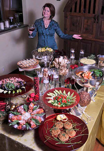 Cheryl Cecchetto, a party planner diva, has cooked up an assortment of her favorite dishes for a Christmas/holiday entertaining story. Ladera Heights, CA.12-02-2010. (John McCoy/staff photographer)