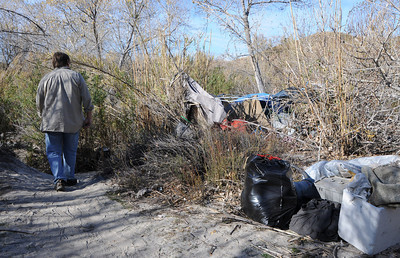 Joe Barrett walks past a homeless camp down in the wash.  Barrett is a local Sunland resident who is trying to help homeless while at the same time trying to keep the environmentally sensitive area clean. Homeless encampments in the Big Tujunga Wash have moved into more remote areas after recent cleanup attempts. Residents in the area are concerned about violence, open fires and drug use in the urban area that is close to homes. Sunland, CA 12/29/2011(John McCoy/Staff Photographer)