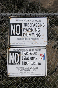 Signs posted on Big Tujunga Canyon Road do little to prevent homeless people from building camp sites next to the was. Homeless encampments in the Big Tujunga Wash have moved into more remote areas after recent cleanup attempts. Residents in the area are concerned about violence, open fires and drug use in the urban area that is close to homes. Sunland, CA 12/29/2011(John McCoy/Staff Photographer)