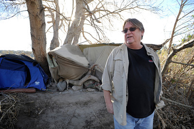 Joe Barrett stands outside a homeless mans camp who lives in the wash. Barrett is a local Sunland resident who is trying to help homeless while at the same time trying to keep the environmentally sensitive area clean. Homeless encampments in the Big Tujunga Wash have moved into more remote areas after recent cleanup attempts. Residents in the area are concerned about violence, open fires and drug use in the urban area that is close to homes. Sunland, CA 12/29/2011(John McCoy/Staff Photographer)
