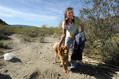 Tammy Whitaker and her dog Apollo live in the Big Tujunga Wash. Homeless encampments in the Big Tujunga Wash have moved into more remote areas after recent cleanup attempts. Residents in the area are concerned about violence, open fires and drug use in the urban area that is close to homes. Sunland, CA 12/29/2011(John McCoy/Staff Photographer)