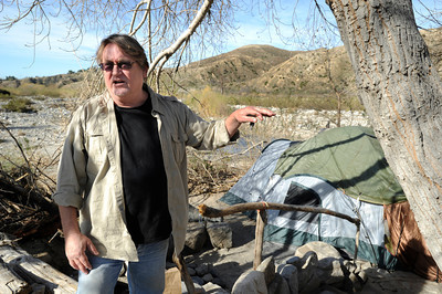 Joe Barrett stands outside the camp of a homeless man who lives in the wash. Barrett is a local Sunland resident who is trying to help homeless while at the same time trying to keep the environmentally sensitive area clean. Homeless encampments in the Big Tujunga Wash have moved into more remote areas after recent cleanup attempts. Residents in the area are concerned about violence, open fires and drug use in the urban area that is close to homes. Sunland, CA 12/29/2011(John McCoy/Staff Photographer)