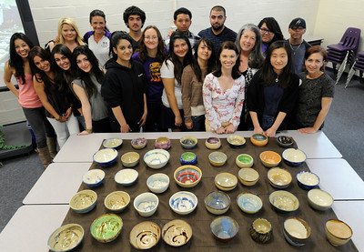 "Students and Family Promise volunteers pose for a photo with 40 bowls that were donated to charity. Hoover High School Advanced Ceramic Students hand made and donated ceramic bowls to the Family Promise of East San Fernando Valley today. Family Promise is an organization dedicated to providing low-income families with basic needs such as food and housing. The bowls will be used at the ""Empty Bowl Fundraiser,"" Sunday March 25 at St. Finbar Community Center in Burbank. The emply bowl symbolizes the hunger and uncertainty homeless families face in their lives. Glendale CA 3/09/2012(John McCoy/Staff Photographer)"