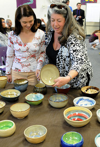 "(l-r) Jacki White and Barbara Lazar, from Family Promis, look at the bowls made by the students. Hoover High School Advanced Ceramic Students hand made and donated ceramic bowls to the Family Promise of East San Fernando Valley today. Family Promise is an organization dedicated to providing low-income families with basic needs such as food and housing. The bowls will be used at the ""Empty Bowl Fundraiser,"" Sunday March 25 at St. Finbar Community Center in Burbank. The emply bowl symbolizes the hunger and uncertainty homeless families face in their lives. Glendale CA 3/09/2012(John McCoy/Staff Photographer)"