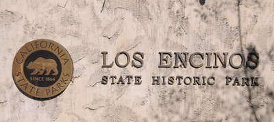 This sign is visible on Ventura Blvd. in front of the Los Encinos State Historic Park, one of 70 state parks threatened with closure because of state budget cuts.  A task force organized by state Sen. Fran Pavley that wants to save the park recently got a reprieve in the form of a $150,000 anonymous donation. That will keep the park open for another year after it was set to close this summer. But the park still needs money to remain open after that as the state budget crisis continues. Encino, CA 1/7/2012(John McCoy/Staff Photographer)