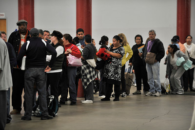 People line up to talk to loan specialists. The second annual Save-the-Dream Event is being held at the Los Angeles Sports Arena. The event brings together lenders and struggling homeowners who hope to get a mortgage modification in order to avert foreclosure. Organizers expect thousands of homeowners during the event, which begins Thursday and runs thru Jan. 30. Los Angeles, CA 1-19-2011. (John McCoy/staff photographer)