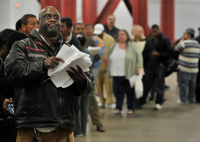 John Miller stands in line with a pile of paperwork that he brought with him to reference when he talks to loan modification people. The second annual Save-the-Dream Event is being held at the Los Angeles Sports Arena. The event brings together lenders and struggling homeowners who hope to get a mortgage modification in order to avert foreclosure. Organizers expect thousands of homeowners during the event, which begins Thursday and runs thru Jan. 30. Los Angeles, CA 1-19-2011. (John McCoy/staff photographer)