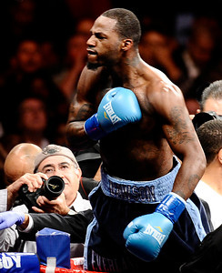Chad Dawson yells back at the crowd as they boo him after he lifted Bernard Hopkins off his feet and fell down to the mat and hurt his shoulder and was not able to continue the fight at the Staples centers. Chad Dawson took the WBC light heavyweight title by TKO in Los Angeles CA. Oct 15,2011. Photo by Gene Blevins/LA Daily News