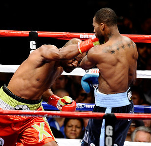 (IN red TRUNKS)Bernard Hopkins looses by TKO in the 2nd round after Chad Dawson lifted Bernard off his feet and down to the mat and hurt his shoulder and was not able to continue the fight at the Staples centers. Chad Dawson takes the WBC light heavyweight title in Los Angeles. CA. Oct 15,2011. Photo by Gene Blevins/LA Daily News