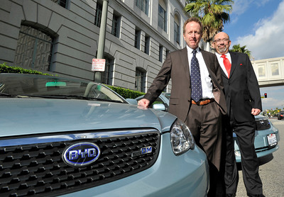 (l-r) Austin Beutner, 1st Deputy Mayor of Los Angeles, and Rudolf Montiel, President and CEO of Housing Authority  City of  Los Angeles with the electric cars that will be used by the Housing Authority who has purchased 10 of the vehicles made by BYD Auto, and imported from China. Los Angeles, CA 12-16-2010. (John McCoy/staff photographer)