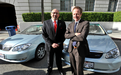 (l-r) Rudolf Montiel, President and CEO of Housing Authority  City of  Los Angeles, and Austin Beutner, 1st Deputy Mayor of Los Angeles, with the electric cars that will be used by the Housing Authority who has purchased 10 of the vehicles made by BYD Auto, and imported from China. Los Angeles, CA 12-16-2010. (John McCoy/staff photographer)
