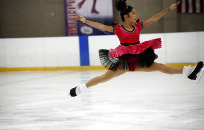 11-year-old Giselle Marquez from Glendale, leaps towards the end of her skating performance during the District 15 Ice Skating Institute Open Championships hosted by the Valley Ice Center in Panorama City, CA. August 10, 2007.  (Ernesto Elizarraraz, Special to the Daily News)