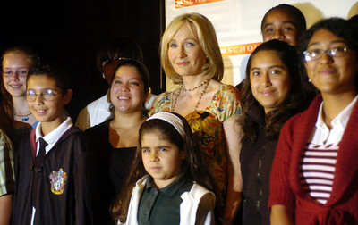 "Author J.K. Rowling poses with children from LAUSD on Monday morning, Oct. 15, 2007, at the Kodak Theatre in Hollywood, CA. during her J.K. Rowling Open Book Tour.  She signed 1600 copies of ""Harry Potter and the Deathly Hallows"".  (Tina Burch/Staff Photographer)"