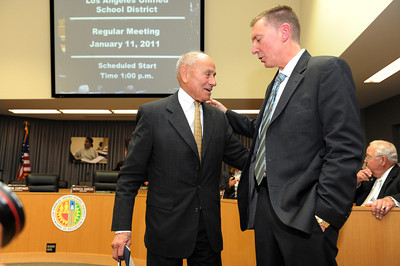 Los Angeles Unified School District Superintendent Ramon Cortines talks to his replacement John Deasy at the LAUSD headquarters boardroom Tuesday, January 11, 2011.  (Hans Gutknecht/Staff Photographer)
