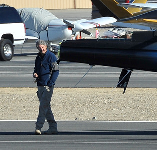 KCAL/KCBS pilot Derek Bell looks over the helicopter he was flying after he made a hard landing Friday, Nov. 12, 2010 at Whiteman Airport in Pacoima. Engine failure has been cited as the cause. (Gene Blevins/Special to the Daily News)
