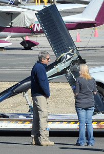 KCAL/KCBS helicopter pilot Derek Bell talks with an NTSB investigator after he made a hard landing Friday, Nov. 12, 2010 at Whiteman Airport in Pacoima. Engine failure has been cited as the cause. (Gene Blevins/Special to the Daily News)