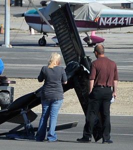 Investigators look over the helicopter KCAL/KCBS pilot Derek Bell was flying after he made a hard landing Friday, Nov. 12, 2010 at Whiteman Airport in Pacoima. Engine failure has been cited as the cause. (Gene Blevins/Special to the Daily News)