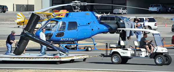 Crew members move the tail rotor that broke of of KCAL/KCBS' Sky9 helicopter after it made a hard landing Friday, Nov. 12, 2010, at Whiteman Airport in Pacoima. Engine failure has been cited as the cause. (Gene Blevins/Special to the Daily News)