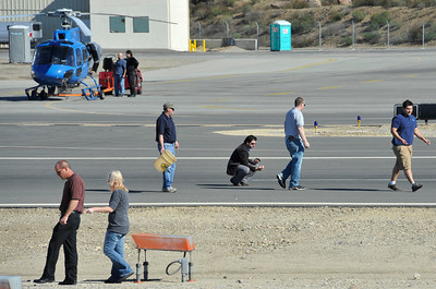 Crew members look for parts from the tail rotor on the runway at Whiteman Airport in Pacoima on Friday, Nov. 12, 2010, after KCAL/KCBS' Sky9 helicopter made a hard landing. Engine failure has been cited as the cause. (Gene Blevins/Special to the Daily News)