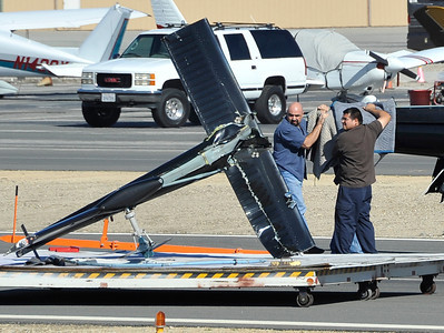 Crew members at Whiteman Airport in Pacoima move the tail rotor after KCAL9/KCBS2's Sky9 helicopter made a hard landing Friday, Nov. 12, 2010, at Whiteman Airpark in Pacoima. Engine failure has been cited as the cause.(Gene Blevins/Special to the Daily News)