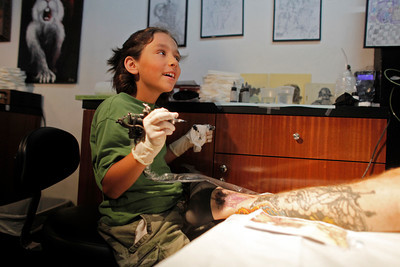 9-year-old tattoos his father